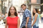 Disloyal_man_with_his_girlfriend_looking_at_another_girl.jpg